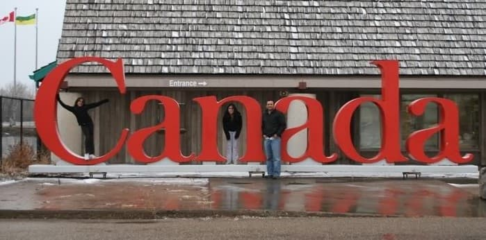 My family happily arriving in Canada! Canada is consistently voted one of the best countries to live in.